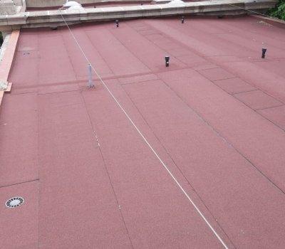 Impermeabilización terraza plana con lámina autoprotegida con acabado de color rojo